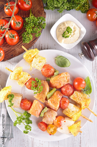 fish salmon and tomato barbecue - skewer on wooden board Canvas Print