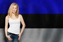 Estonia. Happy Blonde Girl Showing White Banner On Estonian Flag Background