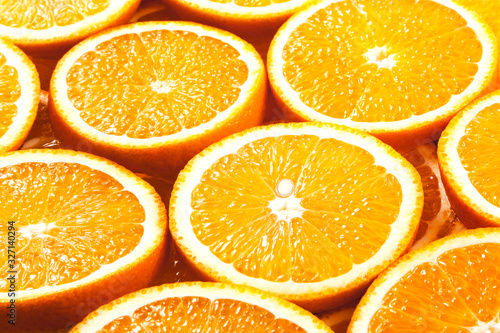 Background from fresh orange slices. Side view.