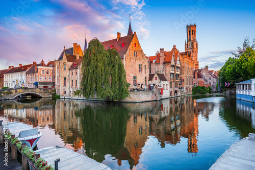 Photo Bruges, Belgium. The Rozenhoedkaai canal and the Belfry.