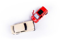 Two Mini Toy Car Crash, Incident, Car Traffic Accident, Frontal Collision Top View, Vehicle Insurance Abstract Concept, Damaged Broken Cars, Cracked Front Light One Door Open, Closeup, Nobody