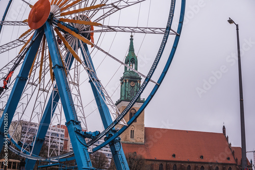 a large wheel with a church tower Canvas Print
