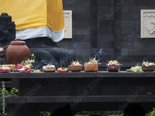 Balinese offerings (sesajen) in a temple (pura) during Kuningan day celebration Wallpaper Mural