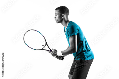 Fotografie, Tablou Afro American tennis player man over isolated white background .