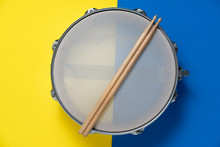 Drum Stick And Drum On Yellow ...