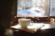 Leinwandbild Motiv Delicious morning coffee and newspaper near window, indoors