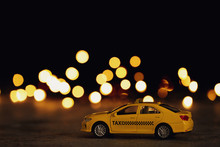 Yellow Taxi Car Model On Table...