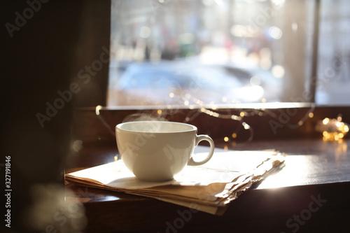 Fototapeta Delicious morning coffee and newspaper near window, indoors obraz