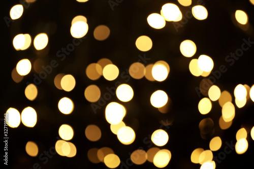 Fototapeta Blurred view of beautiful lights on black background. Bokeh effect obraz na płótnie
