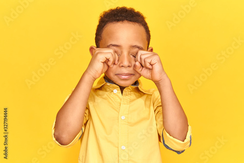 Vászonkép Emotional little African boy crying being capricious does not want to go to sleep
