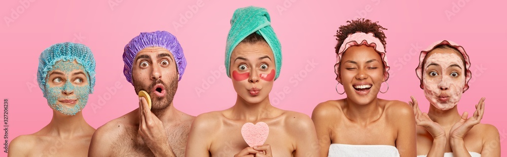 Fototapeta Collage shot of five people appy face masks, hold beauty sponges, stand with bare shoulders indoor, care about appearance and beauty, isolated on pink background. Wellness, cosmetology, spa concept