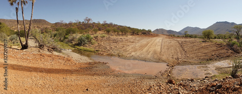 Fototapeta Dry desert landscapes near Epupa Falls waterfall in the Kaokoland of Namibia, Africa