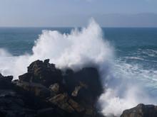 Waves Crashing On A Pier In San Sebastian