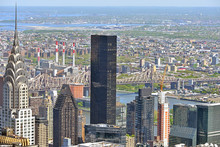 NEW YORK, USA - MAY 11, 2019: Chrysler Building, 100 United Nations Plaza, Trump World Tower And Other Skyscrapers On Background Of Queensboro Bridge