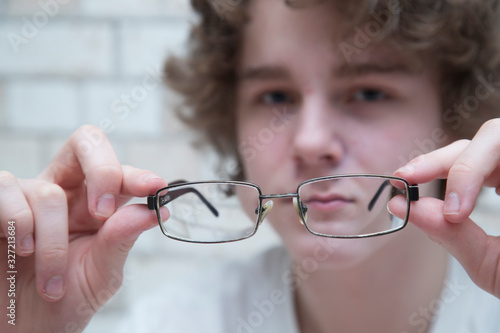 Myopia. Eye problem. Glasses to improve the quality of vision. Wallpaper Mural