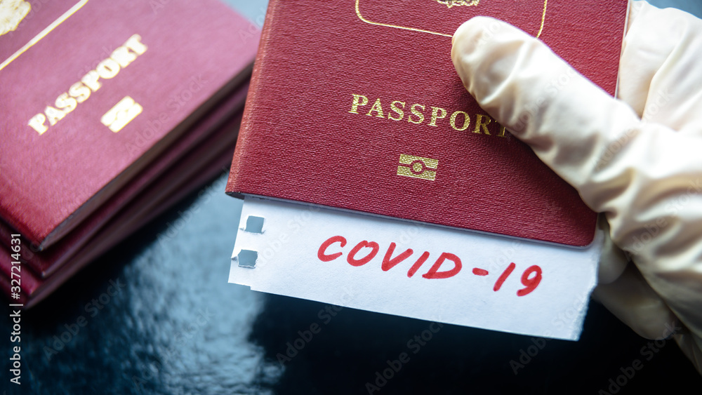 Fototapeta Coronavirus and travel concept. Note COVID-19 coronavirus and passport. Novel corona virus outbreak. Spread of epidemic from China.