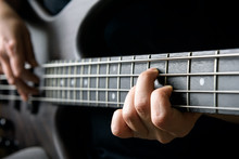 Bass Guitar Player Hand Closeu...