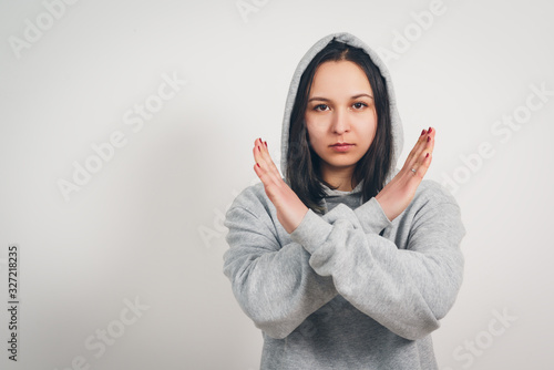 woman with crossed arms. gesture of refusal, abstinence, protest Canvas Print