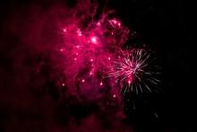 Pink Fireworks With Smoke And Dark Sky