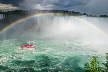 A Boat Under At Rainbow Approa...