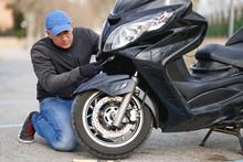 Mechanic Repairing Motorcycle ...