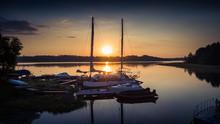 Boat Pier On A Quiet Sunset La...