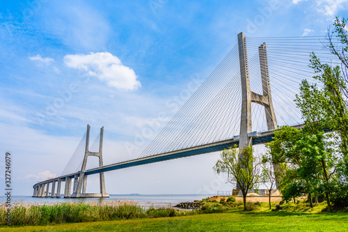 Fotomural Vasco da Gama bridge, a cable stayed bridge flanked by viaducts and rangeviews t