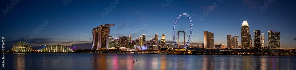 Fototapeta Wide panorama image of Singapore skyline at dusk