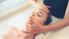 Relaxed Woman Lying On Spa Bed...