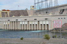 Rapid Changes In Water Level And Do Not Enter The Water Sign Overlooking The Spillway Of The Davis Dam In Laughlin, Clark County, Nevada USA