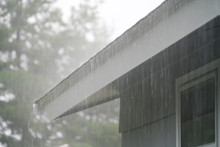 Close Up On Storm Rain On The Roof