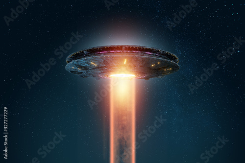 UFO, an alien plate soars in the sky, hovering motionless in the air Fototapet