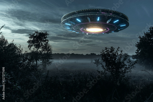 UFO, an alien plate hovering over the field, hovering motionless in the air Wallpaper Mural