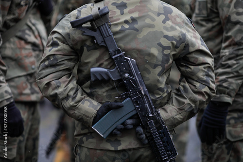 Polish soldier armed with Beryl assault rifle at the Romanian National Day milit Wallpaper Mural