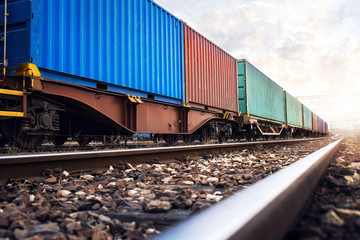 Train wagons carrying cargo containers for shipping companies. Distribution and freight transportation using railroads.