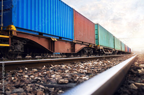 Fotografia Train wagons carrying cargo containers for shipping companies