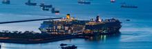 Cruise Ship Anchored At Singapore Port At Magic Hour