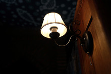 Lighted Lamp On Wall