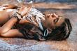 Beautiful young boho stylish woman on the beach close up portrait