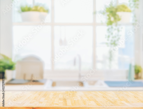 Fotomural Wood table top on blurred kitchen background