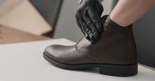 Man Hands In Black Gloves Appl...