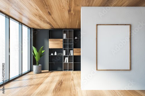 Gray living room with bookcase and poster Fotobehang