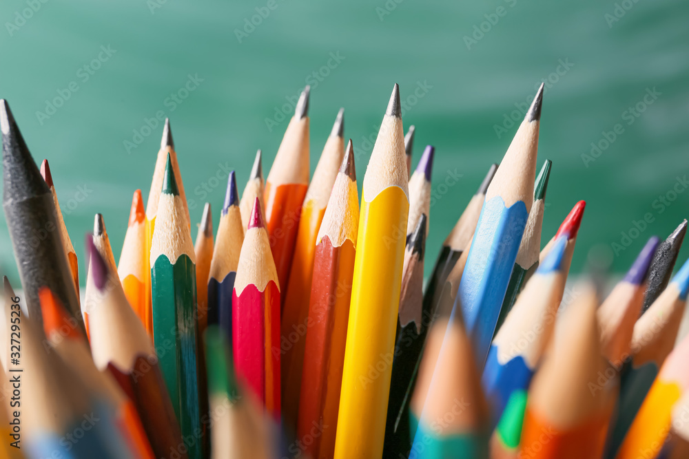 Many different pencils on color background