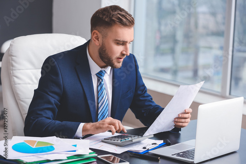 Male accountant working in office Canvas Print