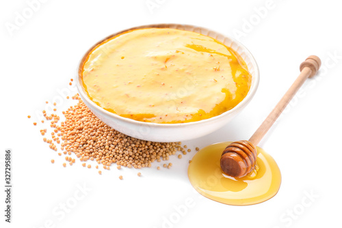 Canvas Print Bowl of tasty honey mustard sauce on white background