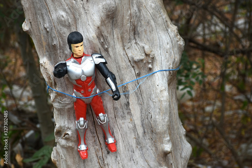 Fotografie, Tablou The hero model is bound by a rope on a tree.