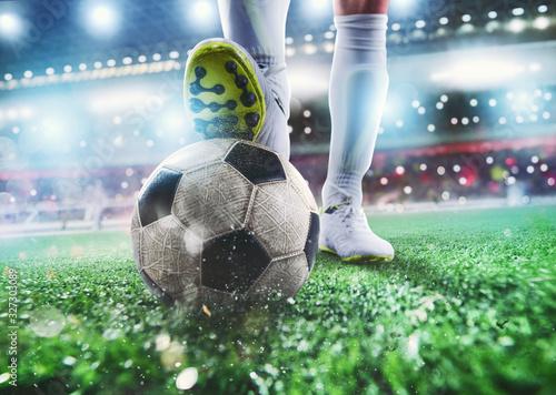 Fotografía Close up of a soccer striker ready to kicks the ball at the stadium