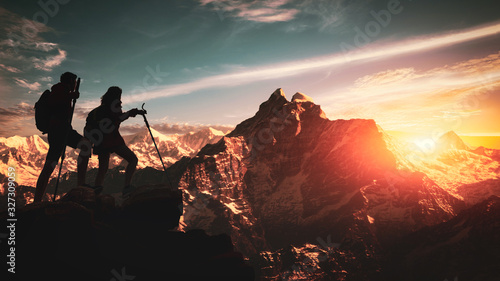 Young asian couple hikers climbing up on the peak of himalaya mountains Fototapet