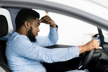 Depressed Man Sitting In Drive...