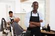 Confident African man hairdresser
